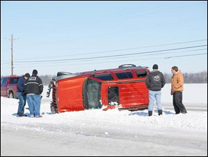 An overturned SUV is stuck on the median between U.S.  20 Eastbound and Westbound near Fremont.