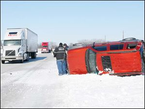 An overturned SUV is stuck on the median between U.S. 20 near Fremont.