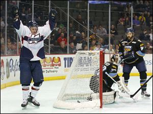 Kalamazoo Wings player Justin Taylor (93) celebrates after scoring a goal on Toledo Walleye goalie Hannu Toivonen (30) during the second period.