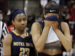 Notre Dame's Jayda Worthy (22) and Christiana Jefferson (23) console each other after the loss.