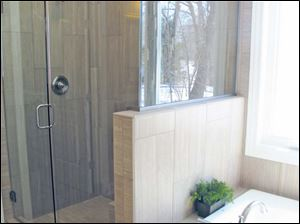 The beautiful master shower is next to an extra deep soaking tub.