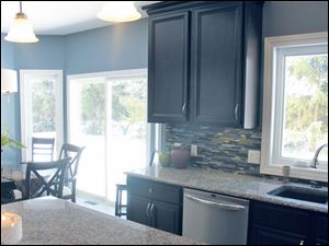 The custom kitchen offers beauty, space and natural light.