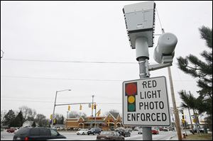 Cleve­land, Day­ton, and Co­lum­bus, along with the broader Ohio Munic­i­pal League, have come to Toledo's de­fense against a Kentucky man's challenge to the city's red-light cameras in the Ohio Supreme Court.