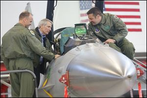 U.S. Sen. Rob Portman, center, speaks with pilots Lt. Col. Scott Schaupeter, left, and Maj. Greg Barasch as they look over an F-16 during Mr. Portman's visit to the Ohio Air National Guard's 180th Fighter Wing near Swanton. Later in the day, he attended the local GOP's annual Lincoln Day Dinner.