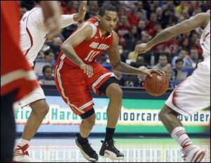 LaQuinton Ross, who led Ohio State with 26 points and 13 rebounds, drives against Nebraska in the Big Ten quarterfinals.