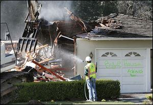 Crews demolish James Bergeron's home in Menlo Park, Calif. The  trend of tear-down is growing anywhere it makes more sense financially or spacewise to start all over again.
