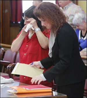 Defendant Candis Sherman with her attorney, Amber VanGunten, cries after she is sentenced in Fulton County to 10 years in prison for the attempted aggravated murder of her son, Logan, then 15.