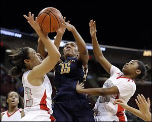 Notre Dame's Kaayla McIntyre, who had 17 points, battles Cincinnati Princeton's Carlie Pogue, left, and Jada Ballew for a rebound in the Division I state semifinal. The Eagles finish 24-4.