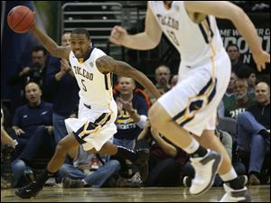 Toledo's Rian Pearson (5) picks up a steal.