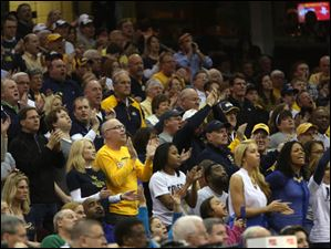 Toledo's fan section stands for their team in the first half.
