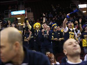 Toledo's Blue Crew and other students cheer on their team from the stands in the second half.