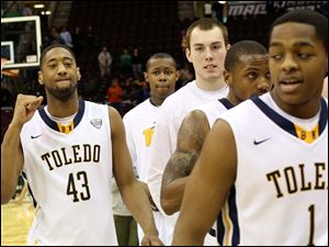 Toledo's Matt Smith (43) celebrates his team's victory as they exit the court.