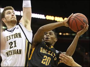 Toledo's Julius Brown (20) attempts to push past Western Michigan's Shayne Whittington (21) in the second half.