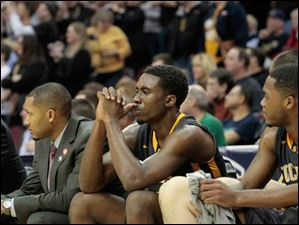 Toledo's Justin Drummond, center, watches the end of the second half.