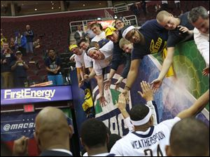 Toledo's J.D. Weatherspoon (24) and his teammates are congratulated by Rocket fans after their win.
