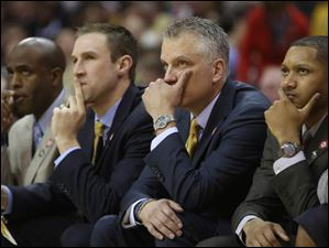 Toledo's head coach Tod Kowalczyk, center right, and his staff watch as the minutes wind down in the second half.