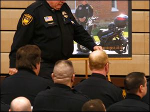 Elmore police chief George Hayes cries after speaking during the funeral service of Jose