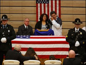Rafael and Belinda Chavez, parents of Jose Andy Chavez, cry during his funeral service.