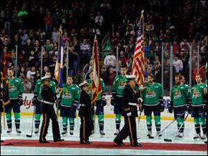 The Toledo Fire and Rescue Honor Guard present the colors during a special pre-game ceremony  in honor of James Dickman and Stephen Machcinski, the two firefighters who died in the line of duty.
