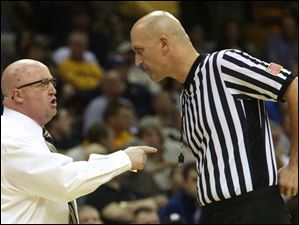 Western Michigan's head coach Steve Hawkins has a word with a referee in the first half.