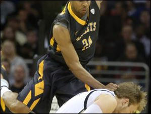 Toledo's J.D. Weatherspoon (24) fouls Western Michigan's Connar Tava (2) in the second half.