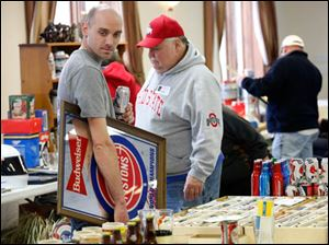 Monroe, Mich. resident Jay Heinzerling carries around a Budweiser Pistons mirror to trade or sell.