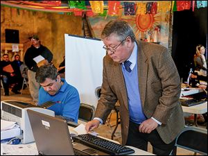 Mexican consul Juan Solana, right, and employee Gabriel Dealba provided outreach services in Toledo on Saturday.