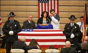 Rafael and Belinda Chavez, parents of Jose Andy Chavez, cry during his funeral service at Woodmore High School in Elmore, Ohio.