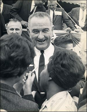 President Lyndon Baines Johnson greets a crowd as he campaigns in Toledo in 1963.