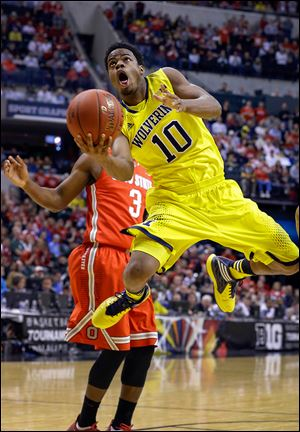 Michigan's Derrick Walton, Jr., goes up for a shot against Ohio State in a Big Ten tournament semifinal.