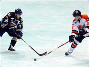 Toledo's David Gilbert and the Komets' William Lacasse fight for the puck.