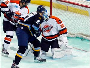 The Walleye's Ryley Grantham scores a goal.