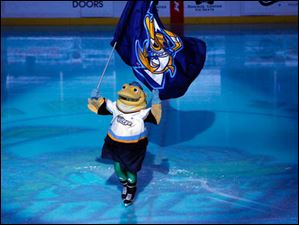 Spike, the Walleye mascot, wears green tights as the ice is tinted green in honor of St. Patrick's Day.