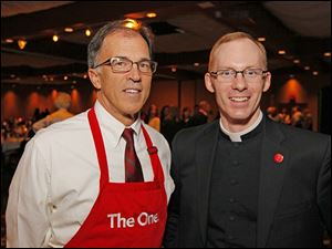 Tom Maj, president of Central Catholic, and Fr. Matthew Radder, Priest Leader at the school, at the Central Catholic Celebrity Wait Night and roasting of Marty Holmes.