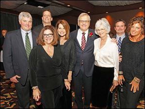 Back row from left: Tom Hurley; Marty Holmes Jr., Marty Holmes and Jay Blaylock. Front row from left: Tammy Fretti; Holly Hurley; Kathy Holmes and Nancy Blaylock at the Central Catholic Celebrity Wait Night and roasting of Marty Holmes.