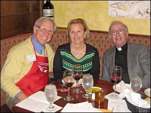 Dr. Ed and Janet Ruszkiewicz; Father Charles Ritter. Ed is an Aurora board member and served as a table captain.