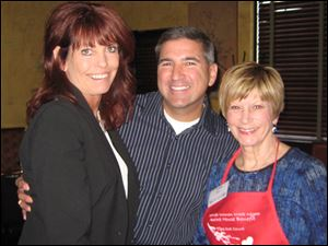 Gayle Ashbridge, Kent Orcutt and Linda Stacy. Linda is Aurora board president and served as a table captain.