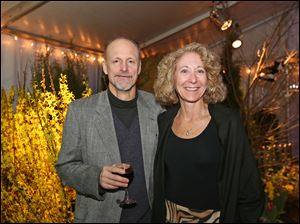 Mark Schmollinger, left, and Sandra Hylint, right, attended the Once Upon a Vine event at the Toledo Zoo.