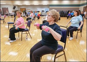Liane Owed of Ottawa Hills, front, works out in the Jazzercise class. The class meets every day for an hour.    The Sylvania Senior Center offers a wide variety of activities and opportunities for area seniors.