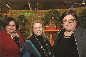 Committee members Elizabeth Foley, foundation board member, left, Ann Sanford, center, and Susan Conda attend the Once Upon a Vine event in the Spring Alive floral exhibit at the Toledo Zoo.