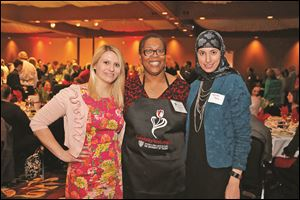 Enjoying the Eberly Center's wait night are, from left, Mariss a Camner, Amanda Bryant-Friedrich , and Tamain Baiz.
