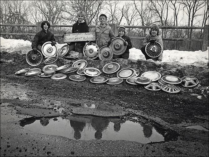 hubcaps.jpg 3-17 Published March 1, 1978. In 1978 potholes were so problematic, some clever youngsters came up with a type of lost-and-found for hubcaps that had apparently come off vehicles after they hit one of these bumps in the road.