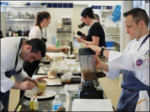 Team USA Chef Philip Tessier, right, works in the kitchen alongside Chef Eli Kaimeh, left.