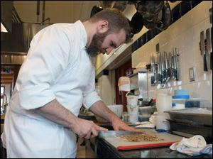 Jonathan Kilroy, who works under Team USA Head Coach Gavin Kaysen, prepares a lamb mosaic.