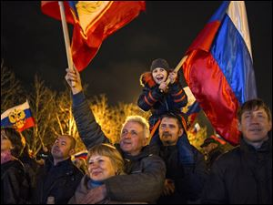 Pro-Russian demonstrators celebrate in Sevastopol, Ukraine, on Monday after residents in Crimea voted  to secede from Ukraine and join Russia.