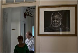U.S. Congressman Jim McGovern, right, takes a tour inside Ernest Hemingway's former home Mo