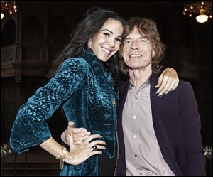 Designer L'Wren Scott, left, girlfriend of Mick Jagger, was found dead Monday in Manhattan of a possible suicide.
