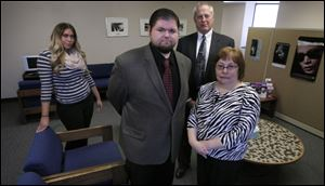 Domestic violence court runner Elizabeth Bolduc, left, chief prosecutor Dave Toska, back, and prosecutors Chris Lawrence and Sharon Gaich show off Municipal Court's new waiting room.