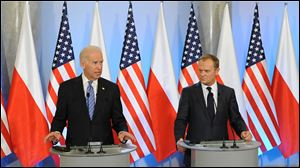 U.S. Vice President Joe Biden, left, speaks to the press after talks with Polish Prime Minister Donald Tusk, right, in Warsaw, Poland, today.