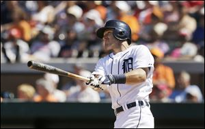 Detroit Tigers' Ian Kinsler watches his three-run home run during the fifth inning of a spring exhibition baseball game against the Toronto Blue Jays.